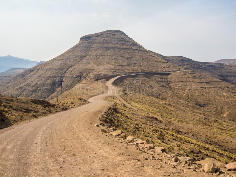 Dangerous and curvy mountain dirt road with steep drop to the valley, Lesotho, Southern Africa.  royalty free stock images