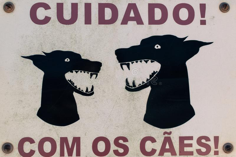 Dangerous dog sign. Posted on a grate of a house near Sagres in the Algarve in Portugal. This photo was taken in June 2016 near a very nice ceramic shop stock images
