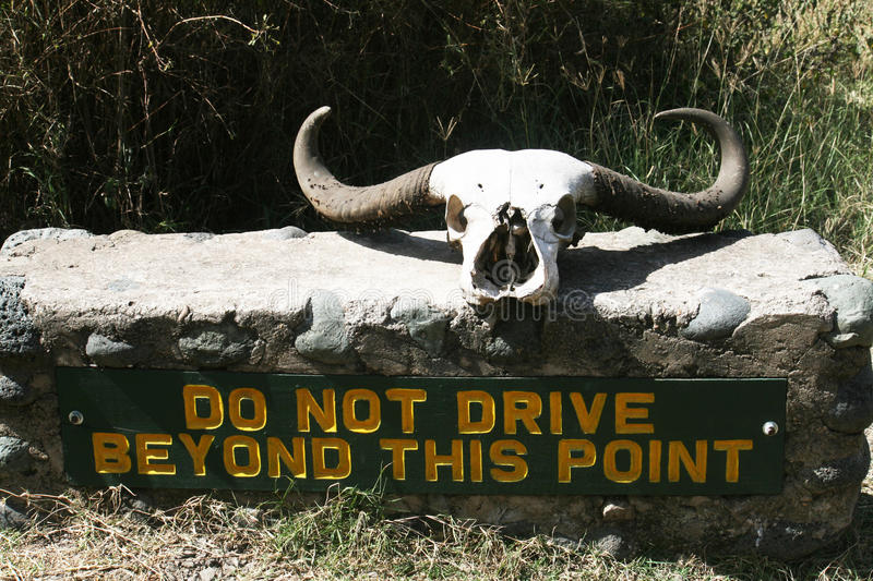 Dangerous drive. A sign inside the arusha national park in tanzania royalty free stock photography