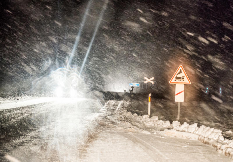 Dangerous driving in winter night royalty free stock images