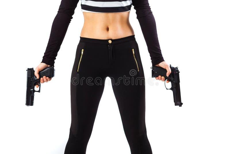Dangerous female assassin holding two guns royalty free stock images