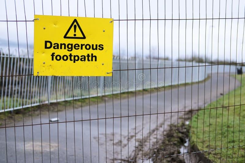 Dangerous footpath walkway sidewalk warning sign for pedestrians walkers people public danger do not walk yellow signage on constr royalty free stock image