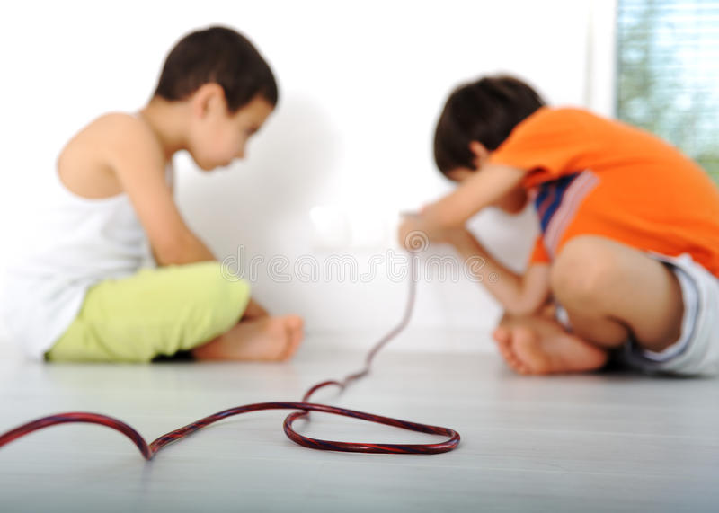 Dangerous game, children experimenting royalty free stock photo