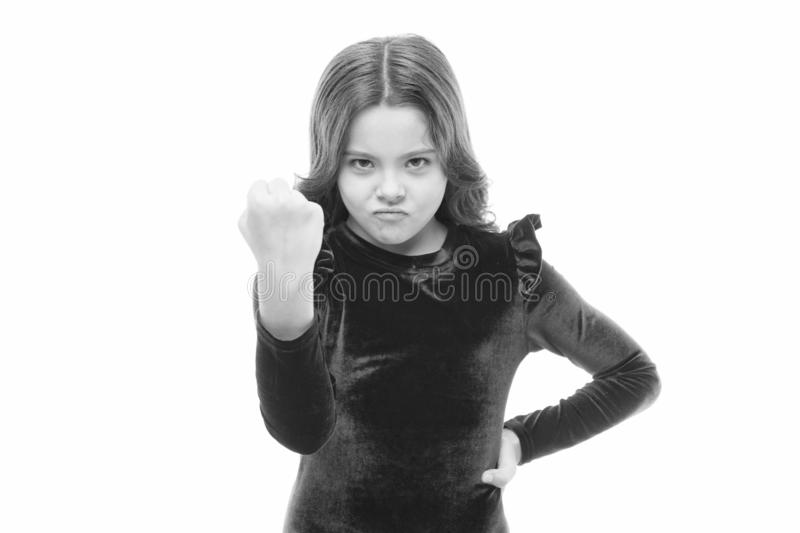 Dangerous girl. Feel my power. Girl kid threatening with fist isolated on white. Strong temper. Threatening with. Physical attack. Kids aggression concept royalty free stock photography