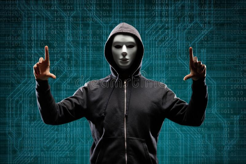 Dangerous hacker over abstract digital background with binary code. Obscured dark face in mask and hood. Data thief. Internet attack, darknet fraud, virtual royalty free stock photo