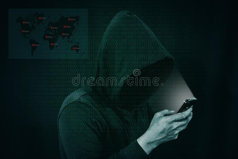 Dangerous hacker stealing data over screen with binary code. Dangerous hacker stealing data over a screen with binary code royalty free stock photography