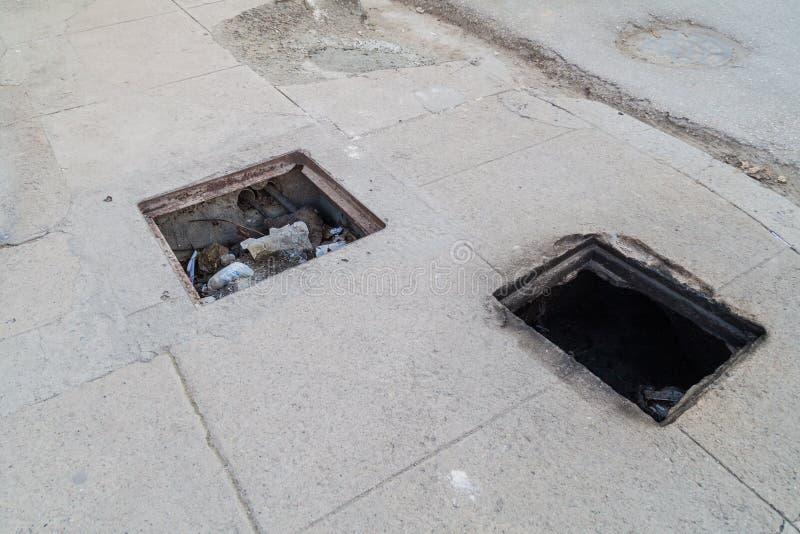Dangerous holes in a sidewalk in Cienfuegos, Cub royalty free stock photos