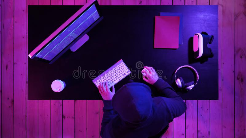 Dangerous Hooded Hacker Breaks into Government Data Servers and Infects Their System with a Virus. stock photos