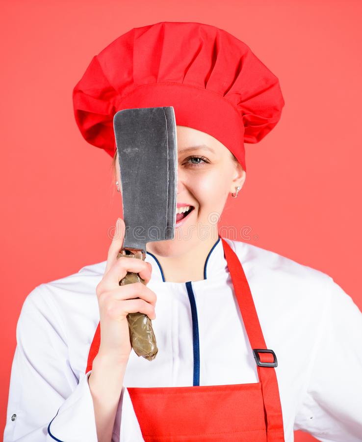 Dangerous lady. Best knives to buy. Stainless steel. Be careful while cut. Woman chef hold sharp knife. Chop food like stock image