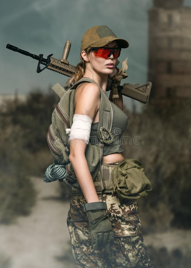 Military girl with automatic rifle. Dooms day stock images