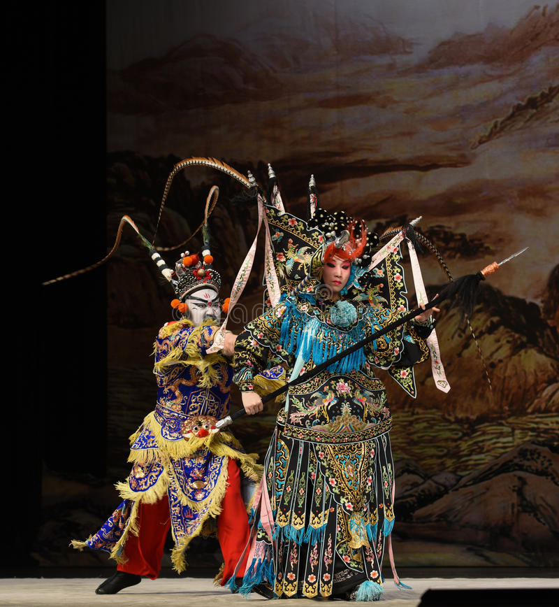 """Dangerous moment- Beijing Opera"""" Women Generals of Yang Family"""". This opera tells a patriotic story how does an old woman of a hundred years old go royalty free stock photography"""