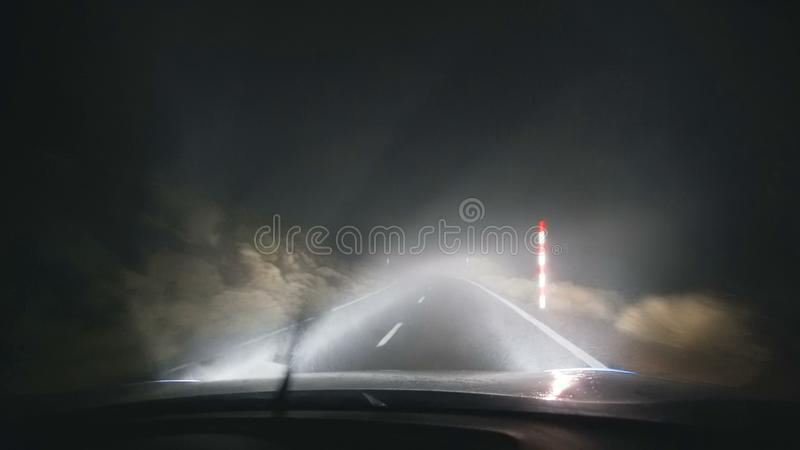 A dangerous night road in the mountains during a hurricane royalty free stock photos