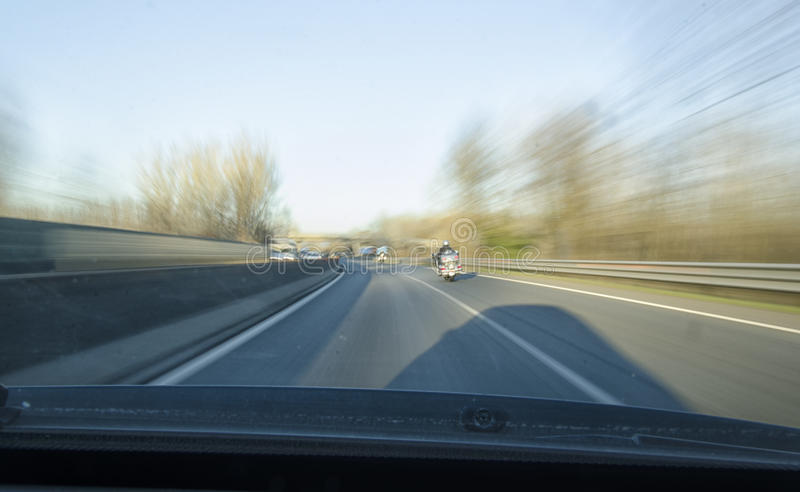 Dangerous overtaking of a chopper. On a highway stock photography