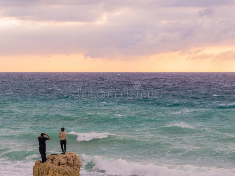 Dangerous photography by the sea royalty free stock photo