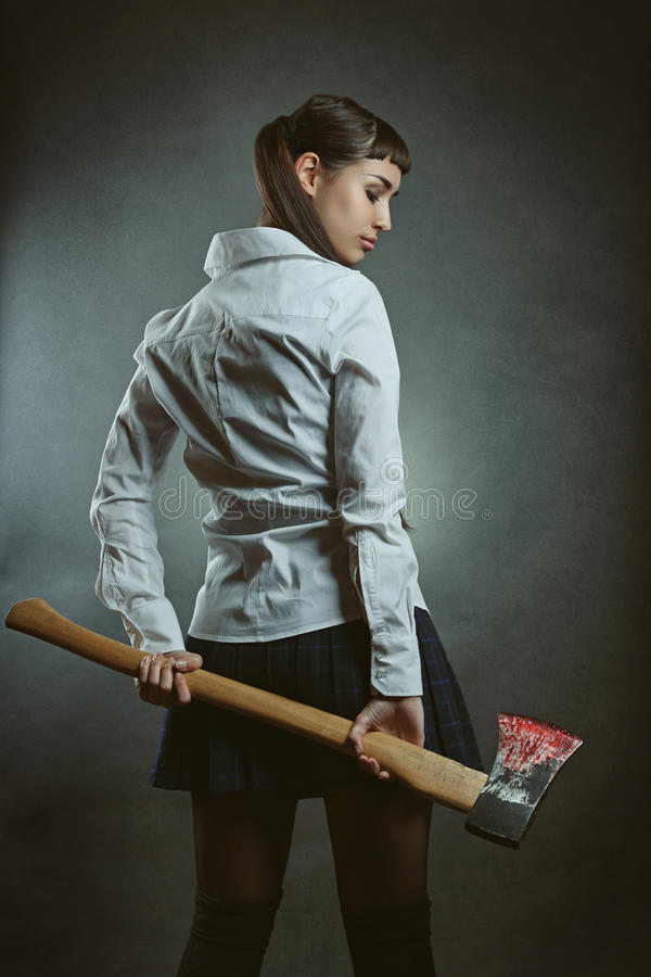 Free Dangerous Psycho Girl With Axe Royalty Free Stock Image - 64226956