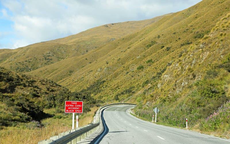 Dangerous road. Crown Range road , New Zealand stock photography