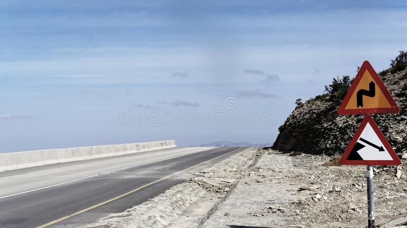 Dangerous road in Oman, with warning signs that have their justification. Travel photo royalty free stock photos