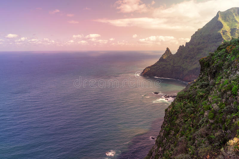 Dangerous rocky cliffs jagged to ocean. stock image