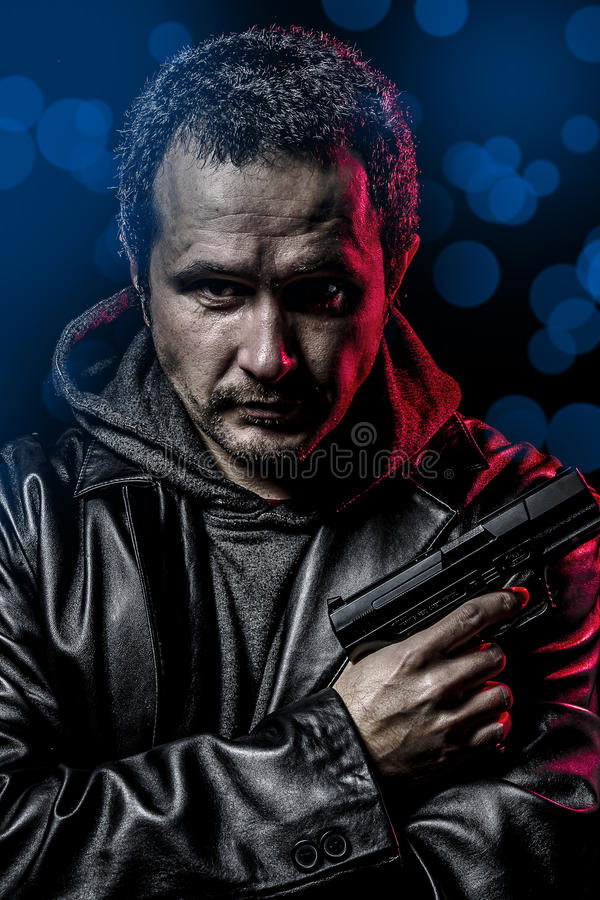 Dangerous Secret Agent With Gun And Police Emergency Lights Stock Photography
