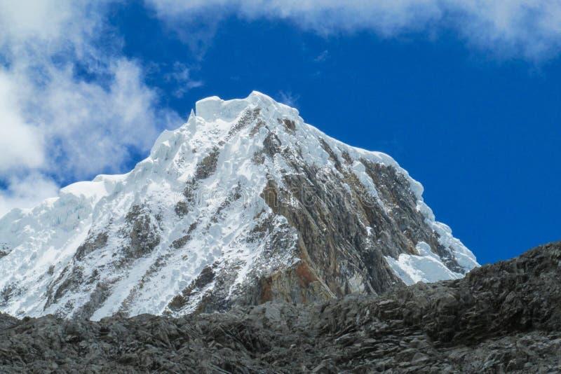 Dangerous snow and rock mountain. Snow capped and glaciar in the mountain peak of Andes mountains in Huascaran, Santa Cruz trekking trek, Peru stock photos