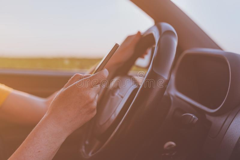 Dangerous texting while driving behavior stock photography