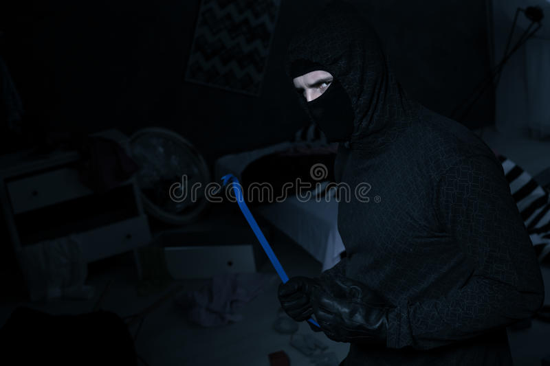 Dangerous thief with wrecking bar royalty free stock photos