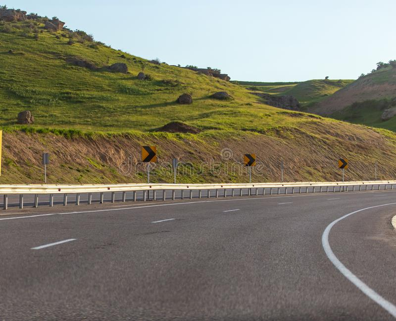 Dangerous turn on an asphalt road in the mountains royalty free stock photo