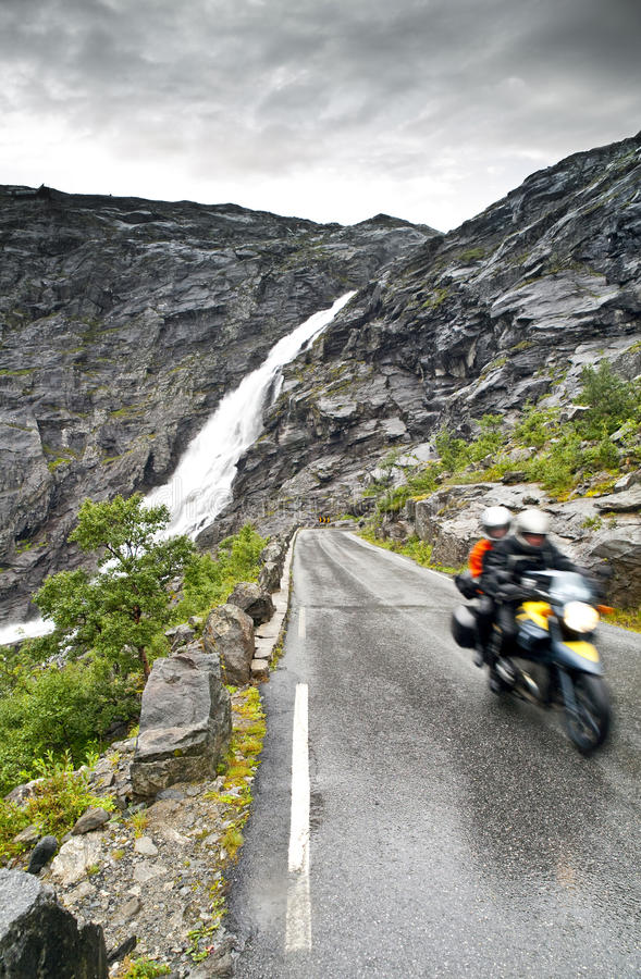 Dangerous wet road. In Trollstigen, a mountain road in Rauma, Norway, part of Norwegian National Road 63 connecting Andalsnes in Rauma and Valldal in Norddal royalty free stock image