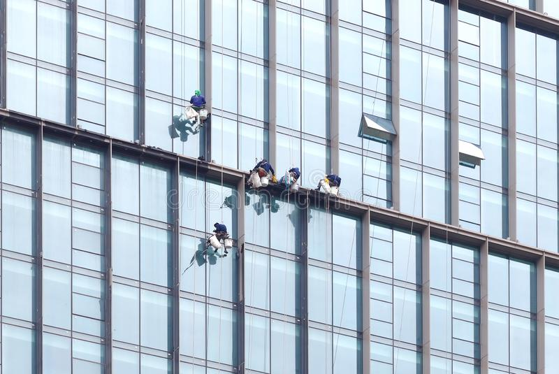 Dangerous working Skycraper Windows Cleaner stock photo