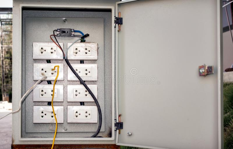 Dangerously Wired Electrical Sockets in a Breaker Box stock photo