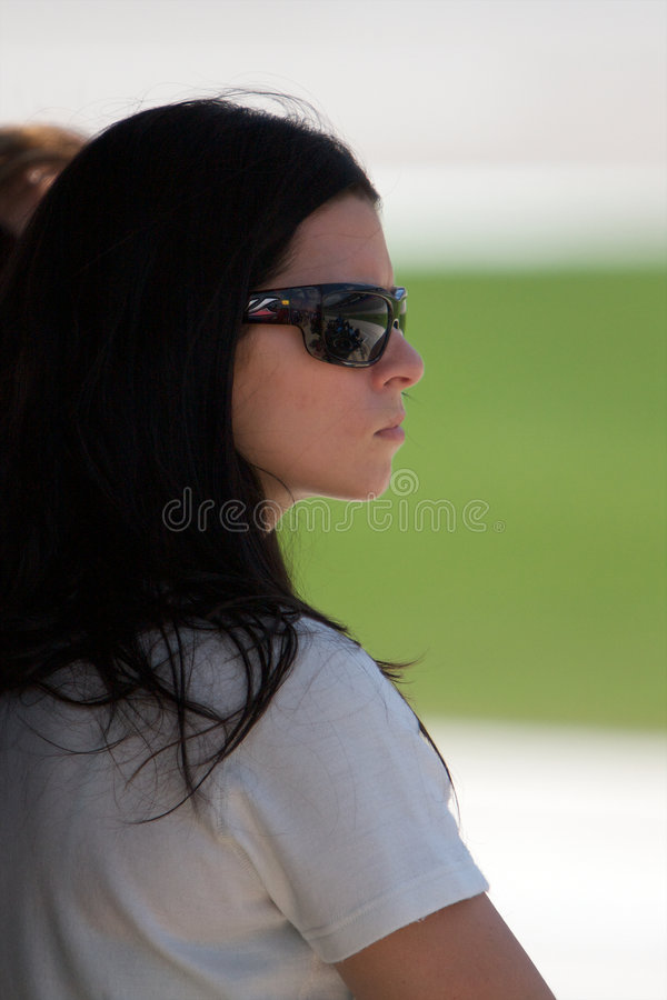 Danica Patrick. Stands in the shade of her pit stall during practice for the Indy Racing League Bombardier Learjet 550k at Texas Motorspeedway in Fort Worth stock image