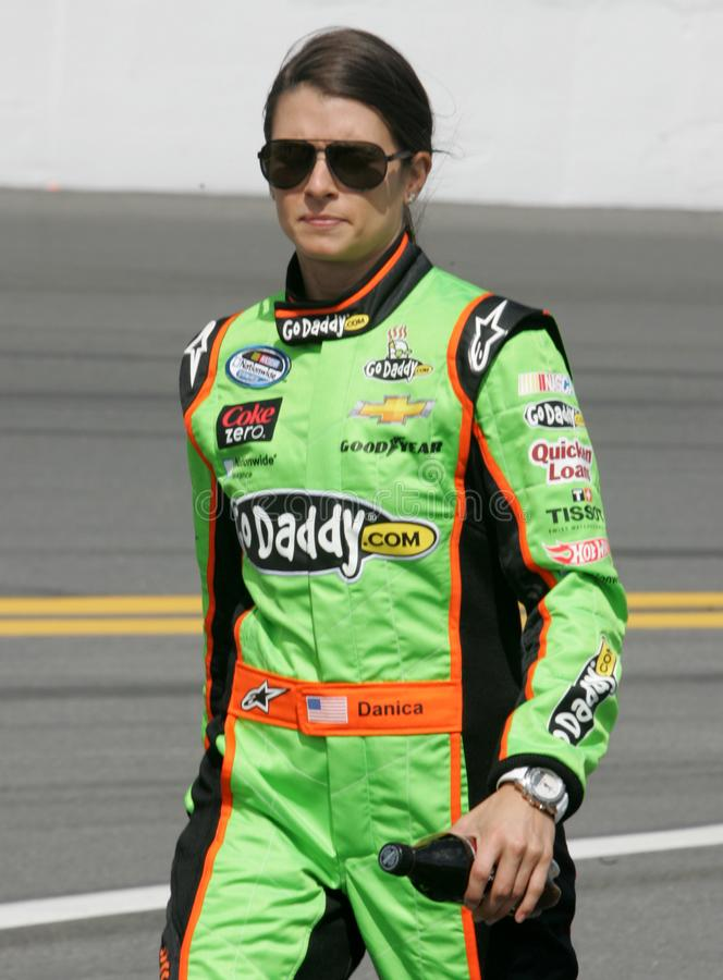 NASCAR Driver Danica Patrick. Danica Patrick walks to her car on pit road prior to the start of the NASCAR Nationwide Series DRIVE4COPD 300, at Daytona royalty free stock image