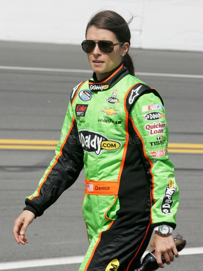 NASCAR Driver Danica Patrick. Danica Patrick walks to her car on pit road prior to the start of the NASCAR Nationwide Series DRIVE4COPD 300, at Daytona stock photo