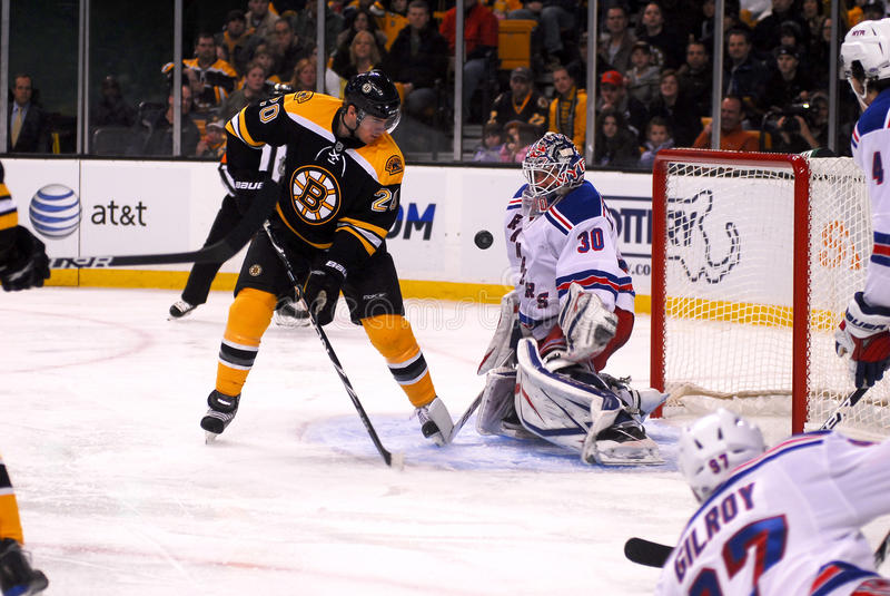 Daniel Paille and Henrik Lundqvist. New York Rangers goalie Henrik Lundqvist blocks a shot against Boston Bruins Forward Daniel Paille stock images
