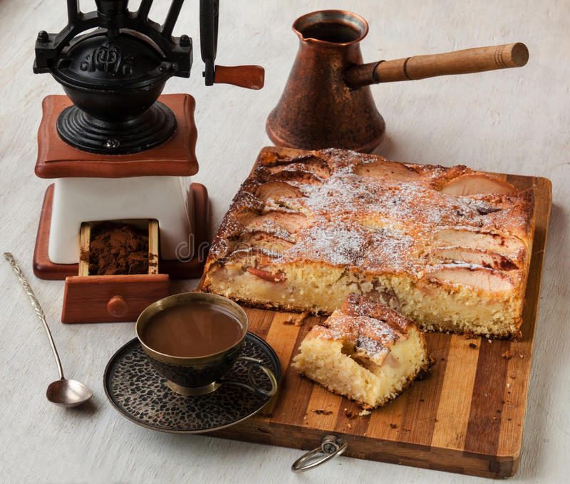 Danish apple cake and cup of coffee. Cup of coffee and apple cake for Danish background grinder stock photo