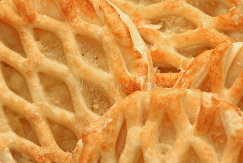 Danish apple lattice pastries. Close-up photo of danish apple lattice pastry cakes ideal for background etc royalty free stock images