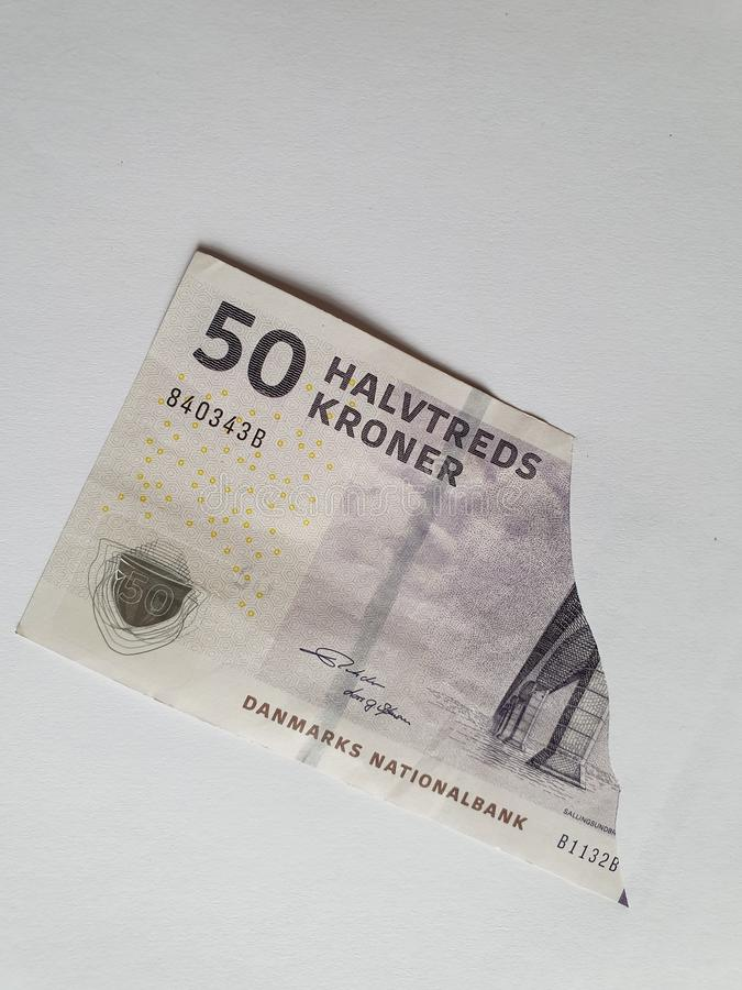 Danish banknote of fifty kroner on the broken sheet of paper. Commerce, exchange, trade, trading, value, buy, sell, profit, price, rate, cash, currency, paper royalty free stock photography