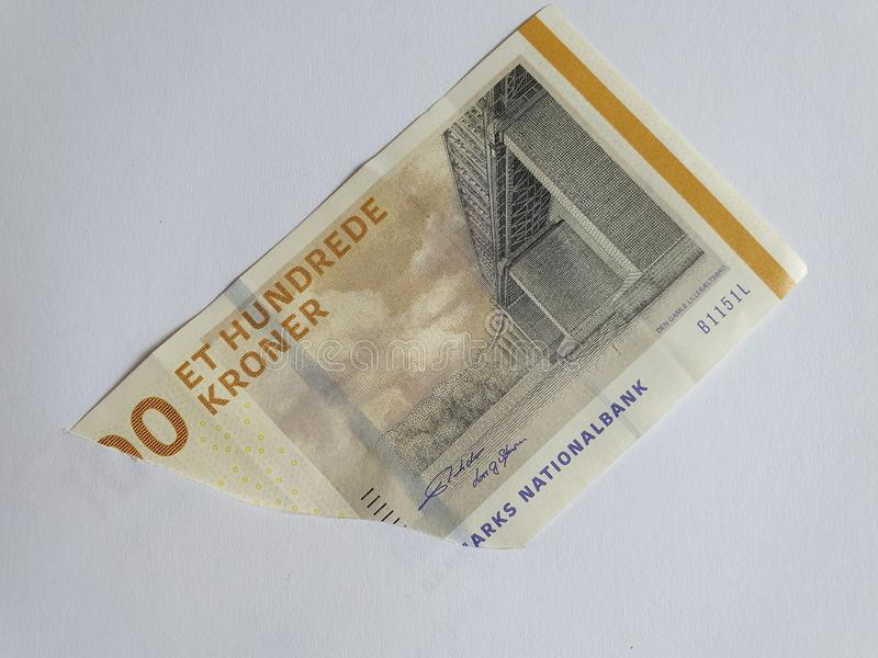 Danish banknotes of 100 kroner on the broken sheet of paper. Commerce, exchange, trade, trading, value, buy, sell, profit, price, rate, cash, currency, paper royalty free stock photos