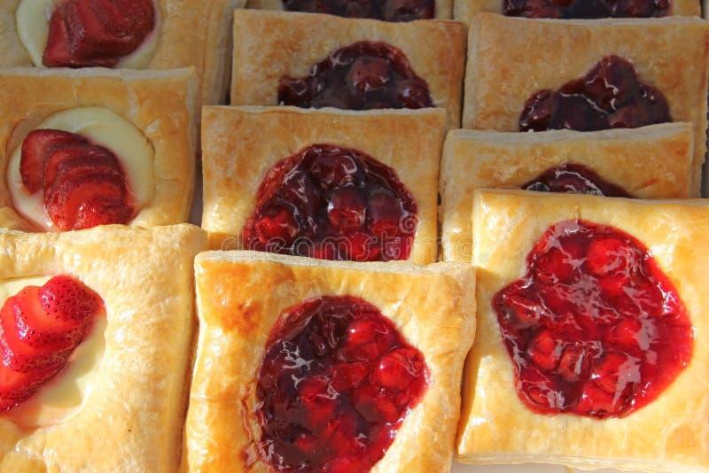 Danish Belgian Bavarian Strawberries Cherries Puff. Danish Belgian Bavarian Strawberries Cherry Filled Puff Pastries freshly made stock photo