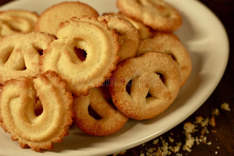 Danish Butter Cookies on white plate royalty free stock photography