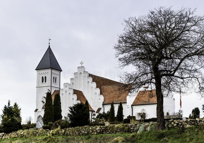 Danish Church with flag pole and Flag. stock photography