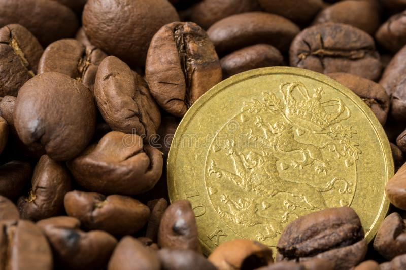 Danish coffee market. Roasted coffee beans and 10 danish krone coin stock images