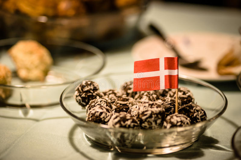 Danish confectionery. Coconut and chocolate confectionery served at christmas time royalty free stock images