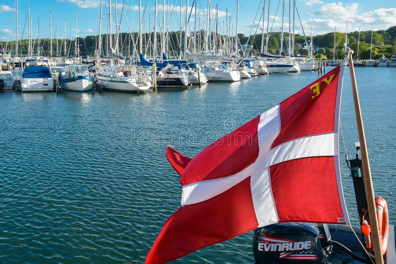 Danish flag in yacht harbour stock image