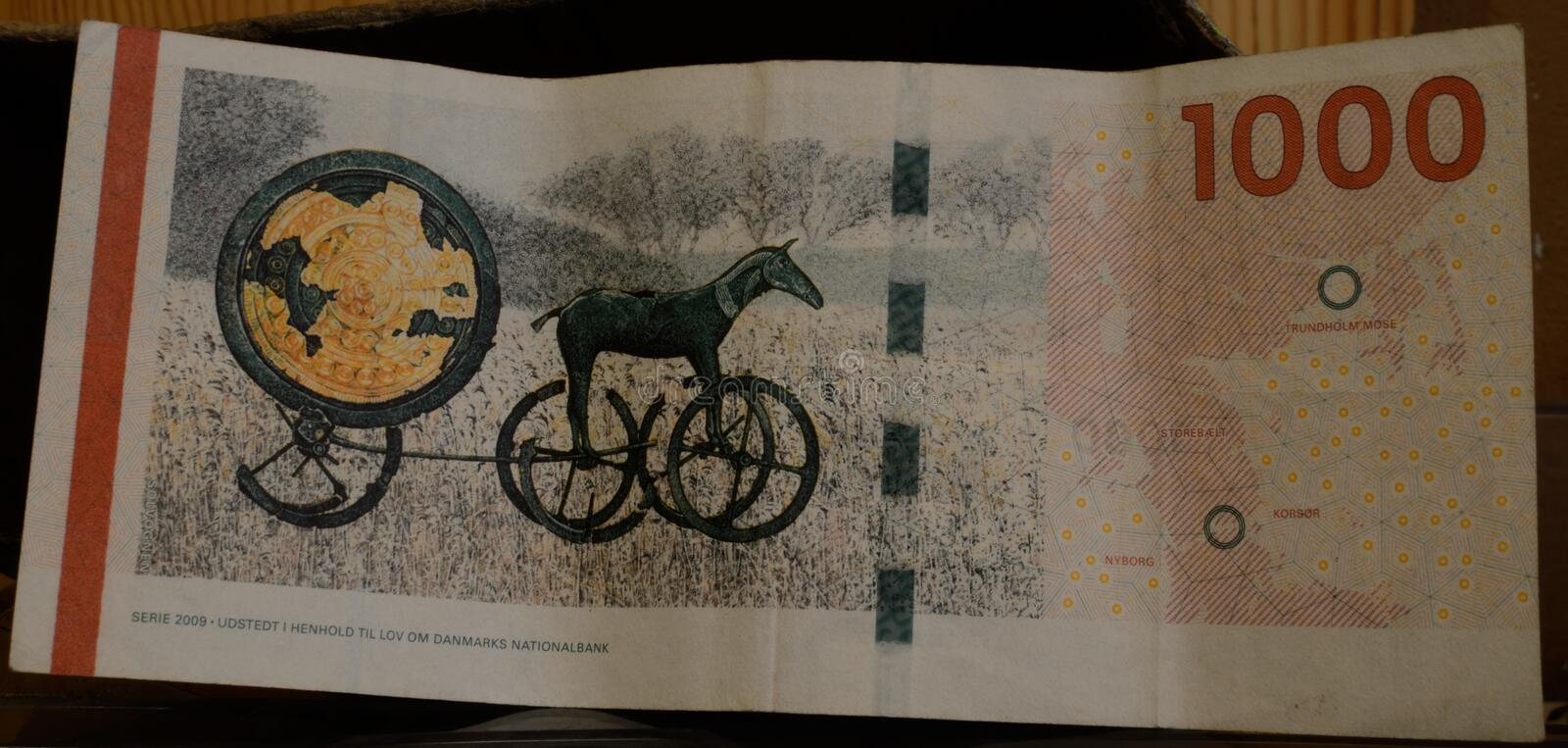 Danish 1000 kr banknote in denmark. Issued by the Danish National Bank. Sun Chariot was found in September 1902, when there was plowed for the first time in stock photos