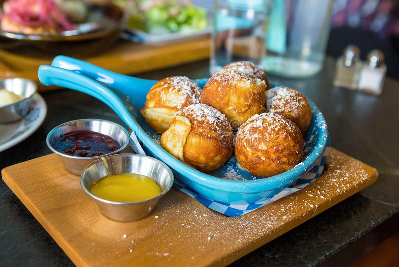 Danish Pancakes with Dipping Jam. Danish pancakes with powdered sugar lemon curd and lingonberry jam dips breakfast dish stock image