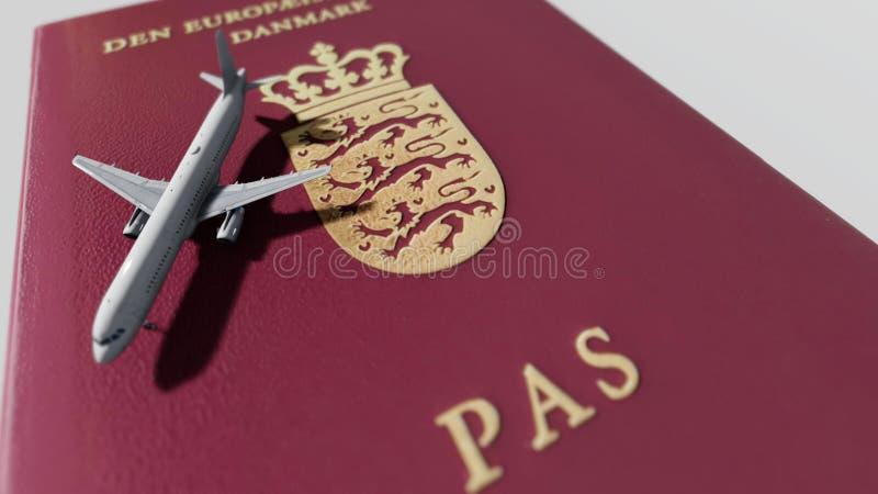 Danish passport an airplane stock photography