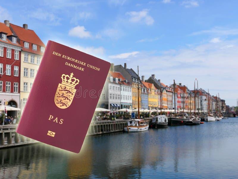 Danish passport in the Nyhavn street royalty free stock photo