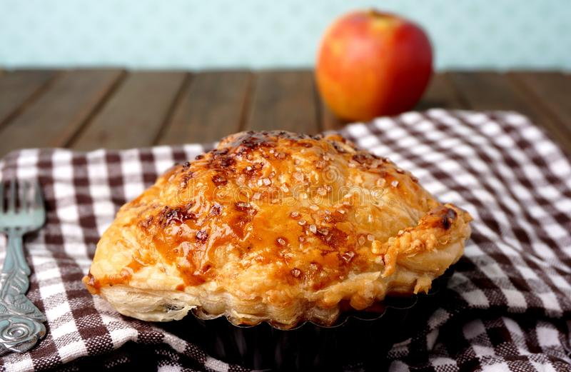 Danish pastries, apple pockets. Danish pastries. Baking. Closeup of danish mini apple pie royalty free stock photography