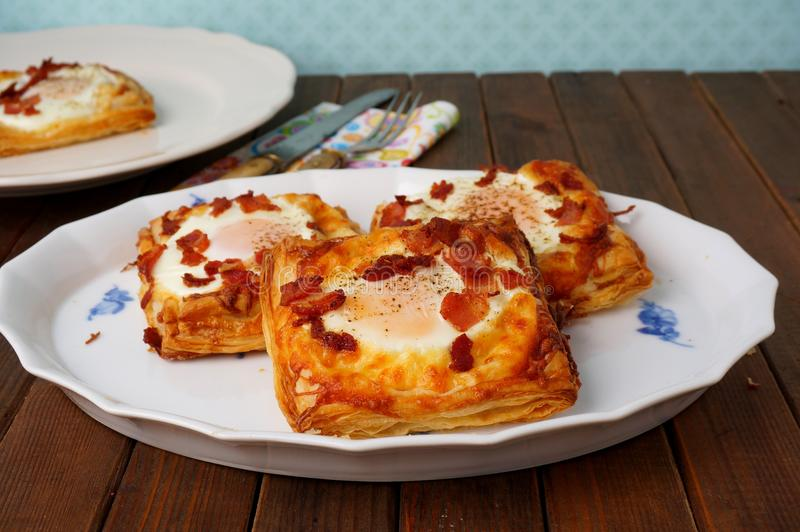Danish pastries, breakfast with egg, bacon, cheese and puff pastries royalty free stock photo